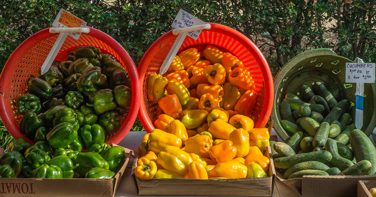 Peppers and cucumbers at a farmers market