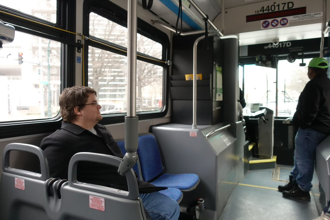 William Cox is a single parent. He relies on the bus to take care of his child.