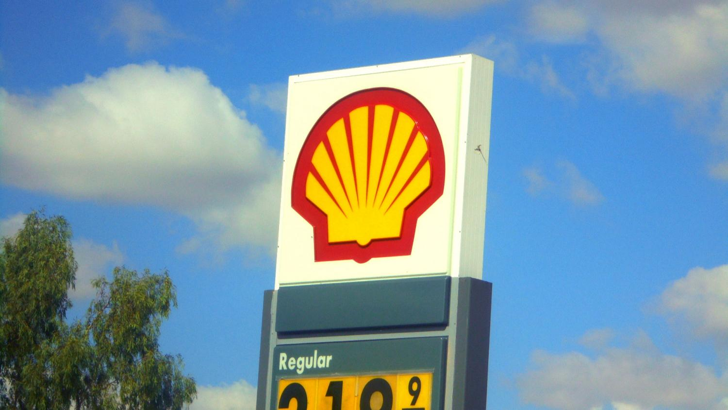 Sign at gas station with Shell logo
