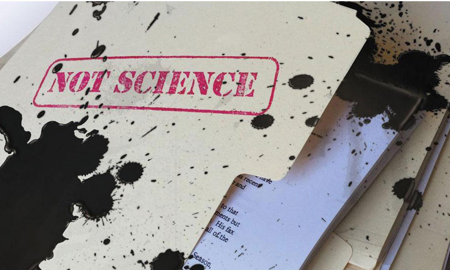 "A file folder with red ""not science"" stamp covered in black oil"