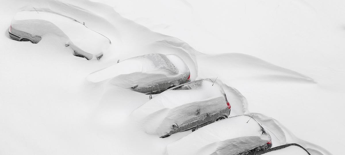 cars covered in deep snow