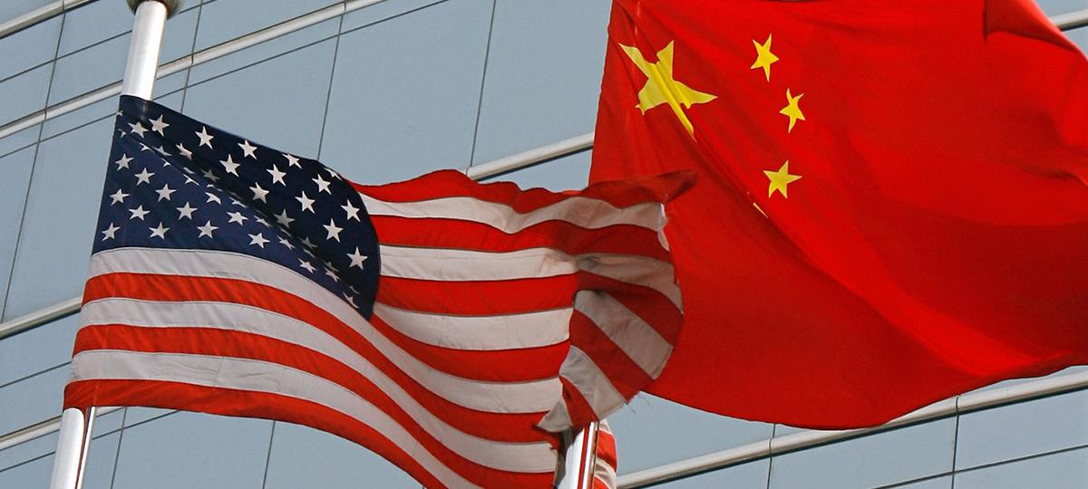 U.S. and China flags flying beside one another.