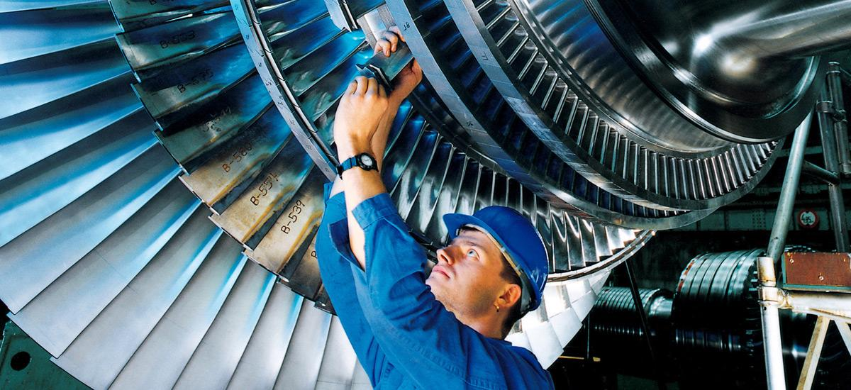 A worker and a power plant turbine