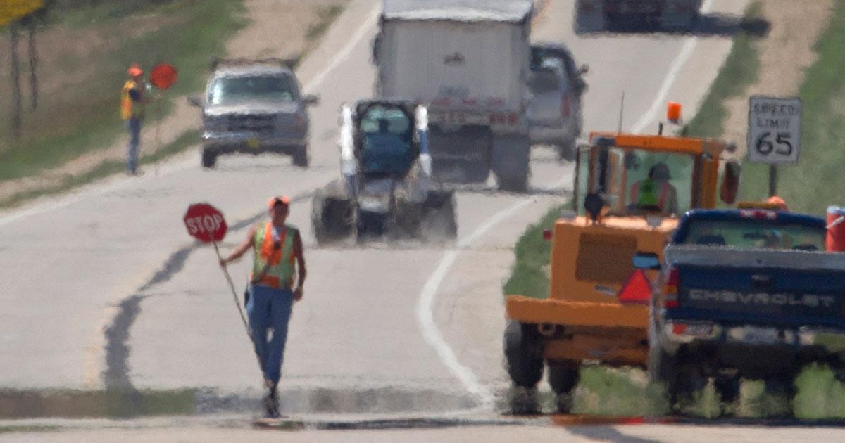 worker in hot roadway