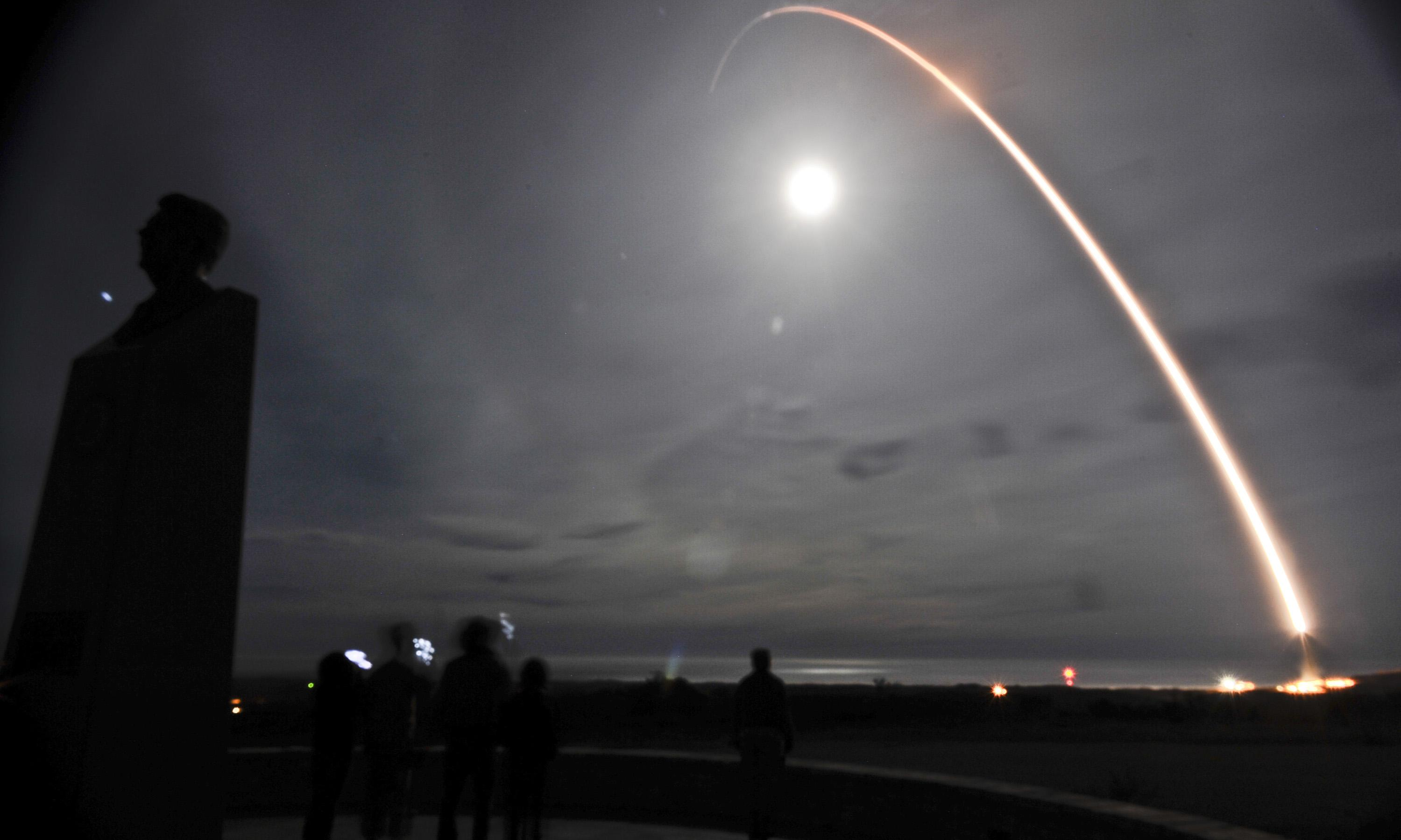 A missile being launched at night