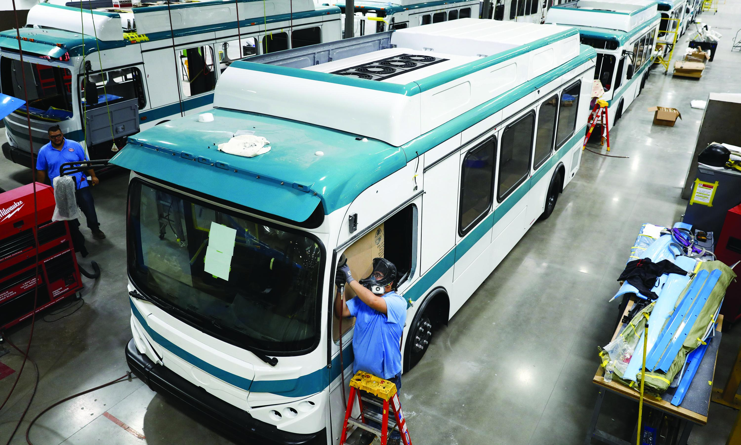 Workers construct electric buses