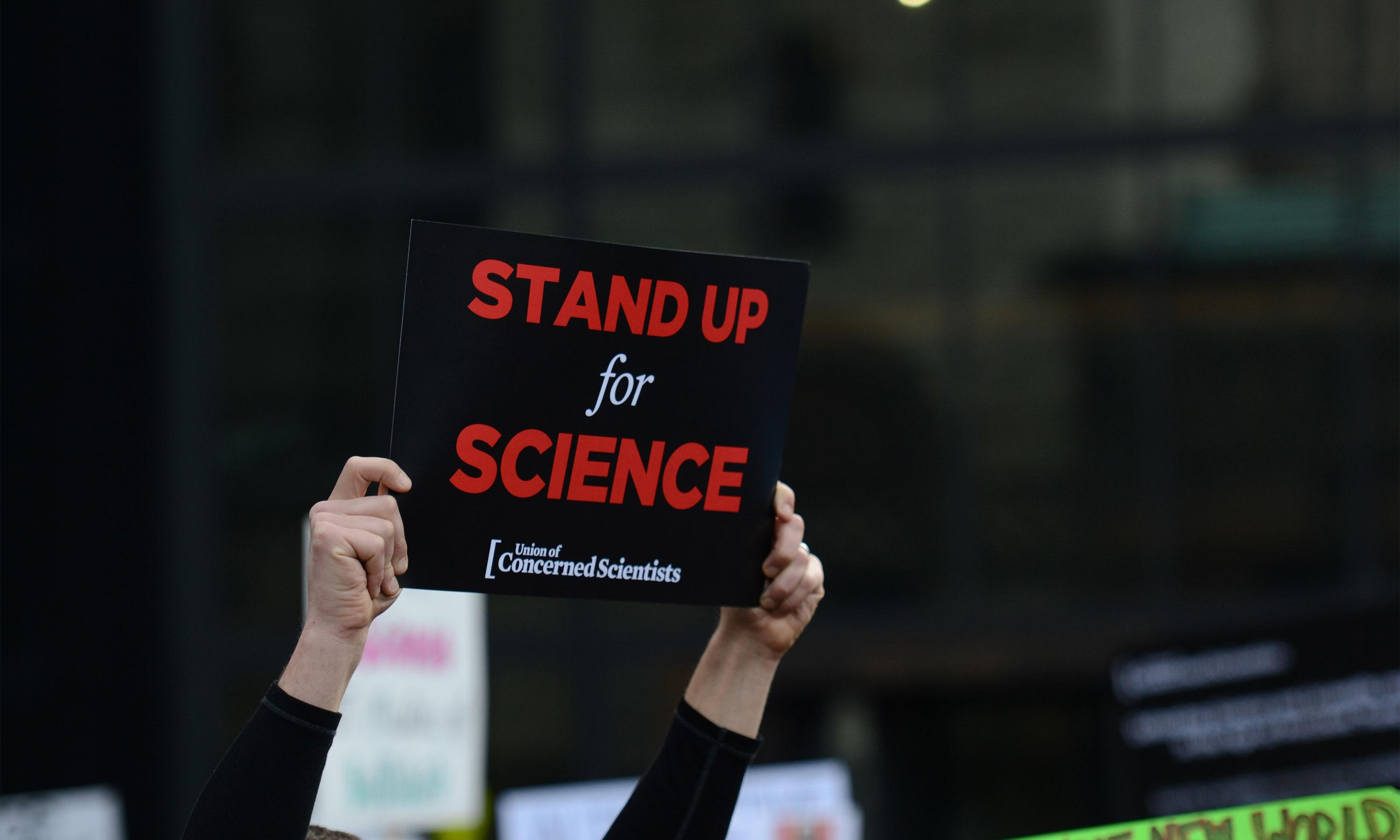 Stand up for Science sign held high