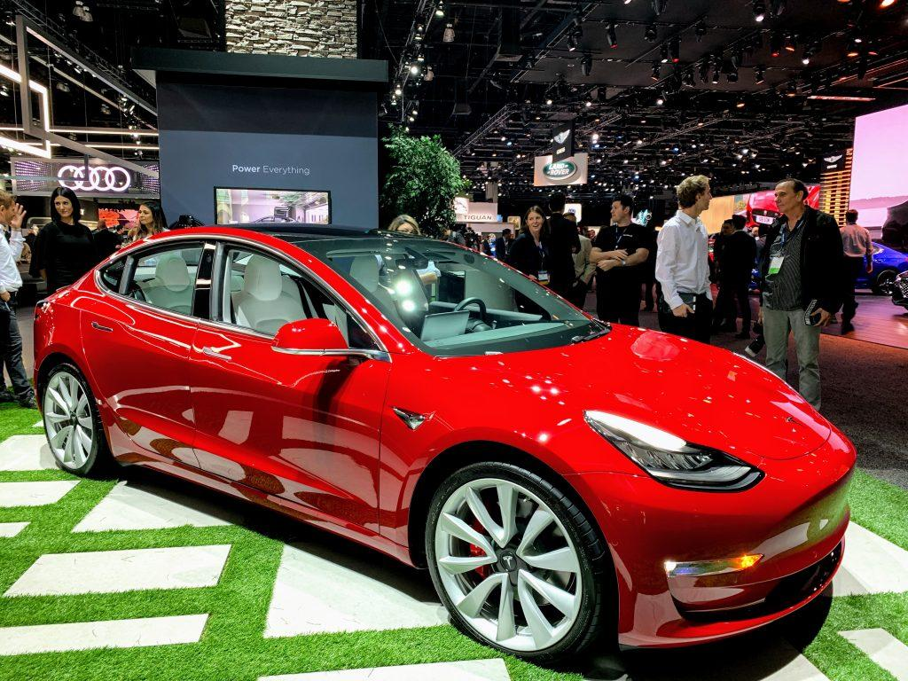 Red Tesla Model 3 at the 2019 LA auto show