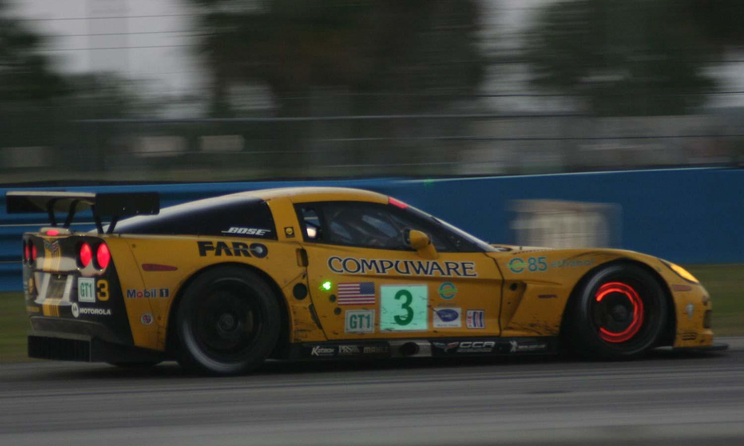 a yellow corvette with glowing brakes at the 2008 12 Hours of Sebring event