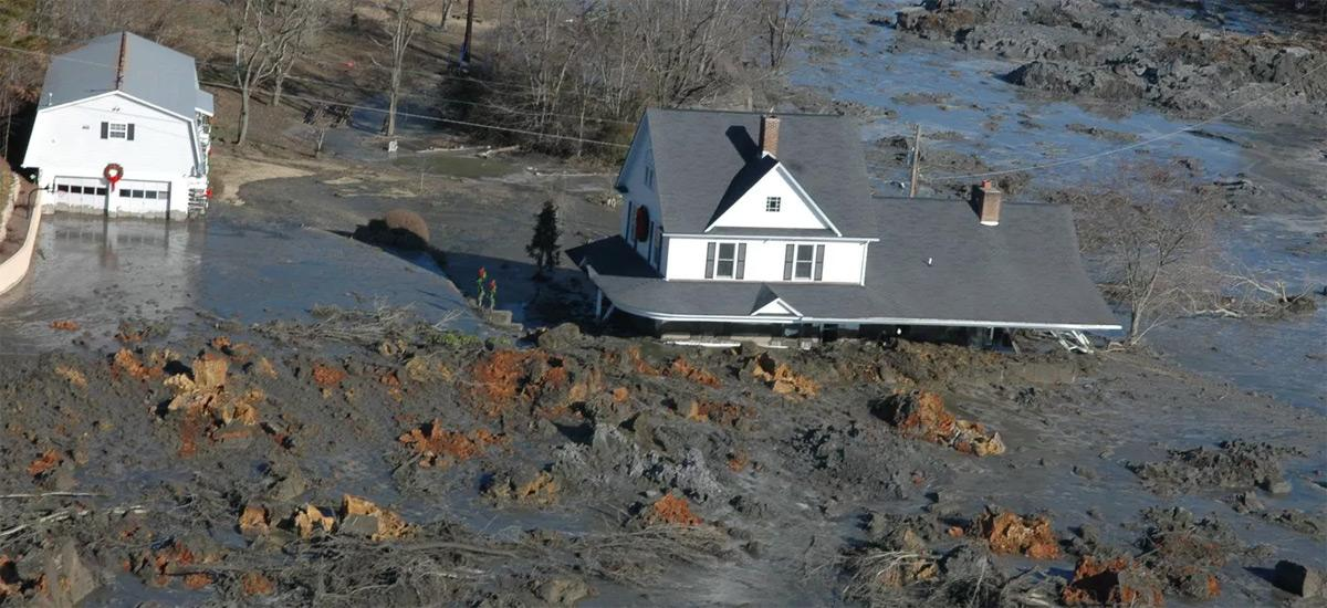 A house partly submerged in a coal ash spill
