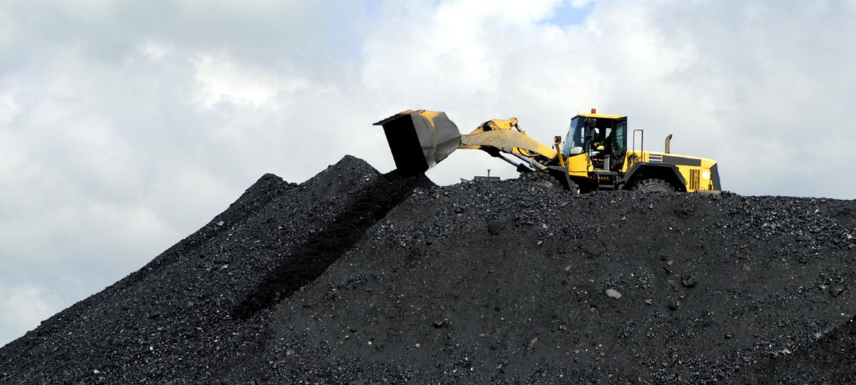 A front end loader working with coal
