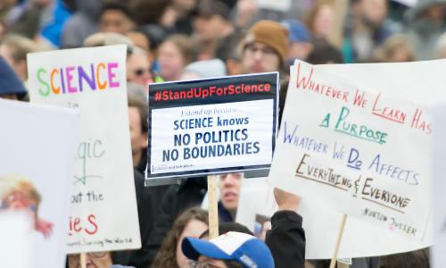 Signs at pro-science rally