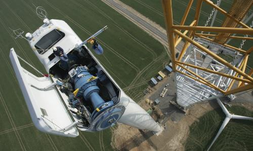 Birds eye view of works on top of a wind turbine.