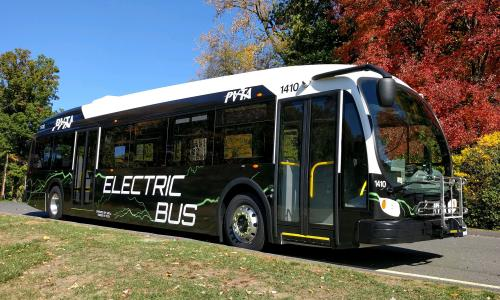 Electric bus in New England on fall day