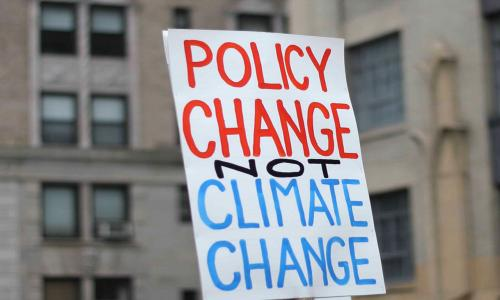 Sign saying Policy Change not Climate Change