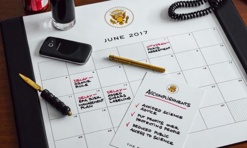 A desk planner showing Trump's anti-science agenda