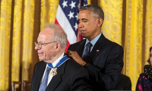 President Obama awarding a medal to a member of the UCS board