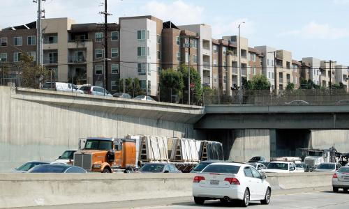 California freeway with housing complex above