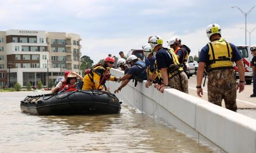 Raft rescuing flood victims in Houston, TX