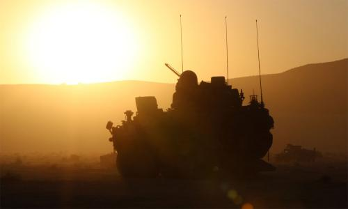 tank silhouette facing blazing sun