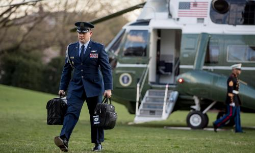"U.S. military aide carries ""president's emergency satchel,"" across White House South Lawn"
