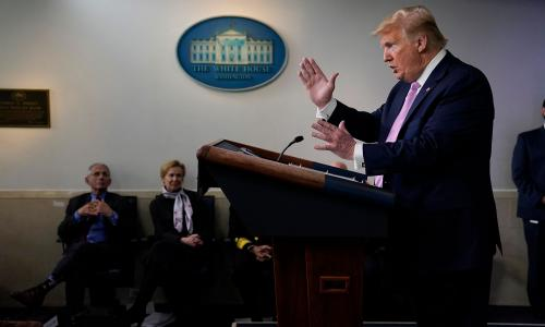 President Trump at a COVID-19 briefing with Anthony Fauci and Deborah Birx in the background
