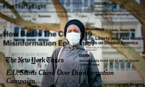 Woman in protective mask with newspaper headlines