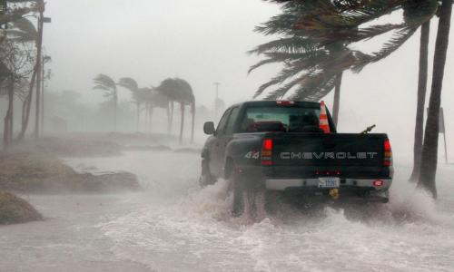 truck driving in flooded waters on key west florida