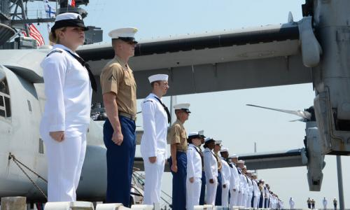 sailors standing at attention on deck