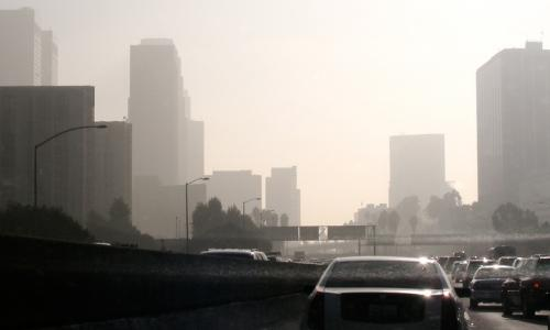 Cars in traffic producing air pollution on LA's Pasadena highway.